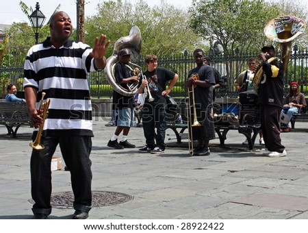 NEW ORLEANS, LOUISIANA - APRIL 13: A jazz band plays in Jackson Square April 13, 2009 in New Orleans, Louisiana after recovery from hurricane Katrina just before the Jazz and Heritage Festival.