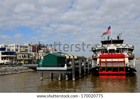 NEW ORLEANS, LOUISIANA - JANUARY 4: the steamer NATCHEZ is docked on the Mississippi River at the New Orleans French Quarter on January 4, 2014.  The ship offers cruises along the Mississippi River.