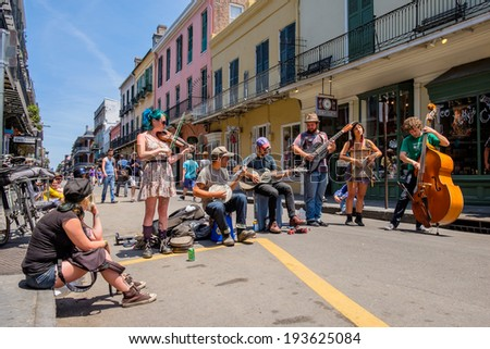 NEW ORLEANS, LOUISIANA USA - MAY 1, 2014: Unidentified street performers playing blue grass style music in the French Quarter district in New Orleans, Louisiana.