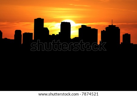 New Orleans skyline at sunset with beautiful sky