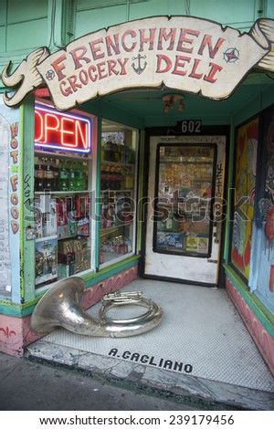 NEW ORLEANS, USA - JULY 24, 2014: A tuba rests in the colorful entrance to a store named Frenchmen Grocery in the French Quarter.