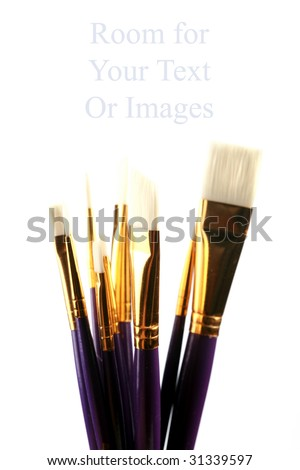 new paint brushes with room for your text or image isolated on white