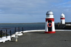 New Pier lighthouse in Castletown on the south of the Isle of Man. The seas are clear and people come here to see marine animals like basking sharks, harbour porpoises or seals