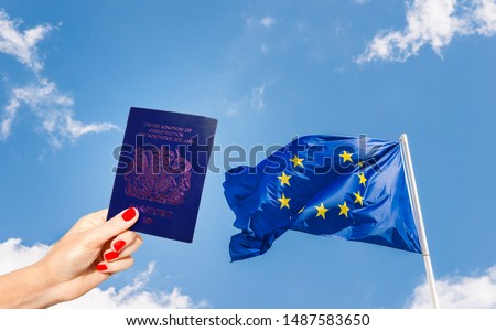 New post-Brexit blue UK passport with European Union flag minus one star against a blue sky. Blue coloured passports will be phased in slowly from 2020 #1487583650