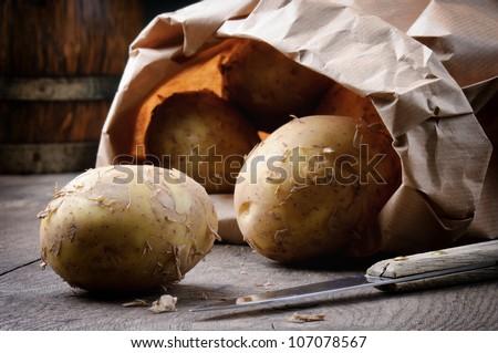 New potatoes in a brown paper bag