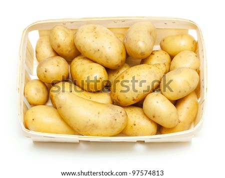 new potatoes in basket isolated on white background