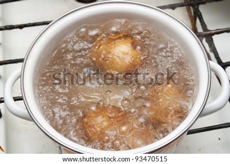 New potatoes simmering in boiling water