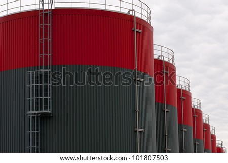 new red and gray oil storage tanks