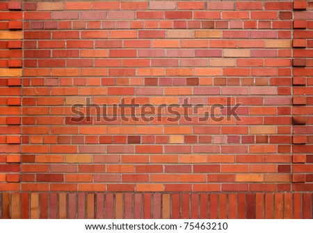 New red brick wall with different shades of red and orange and a designed border