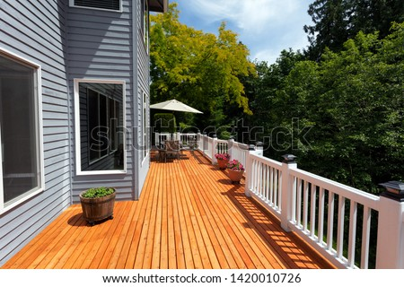 New red cedar outdoor wooden deck during nice weather in horizontal layout   Stock photo ©