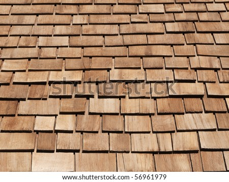 New red cedar shake roof on a high Sierra mountain cabin. - stock photo