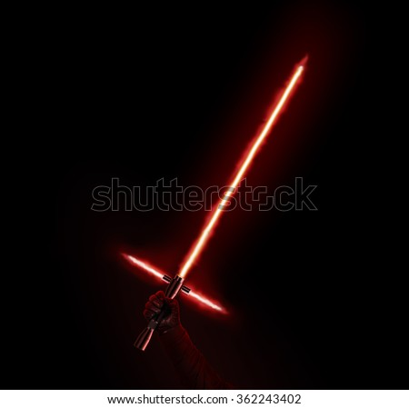 New red light saber holdng in hand isolated on black. Lightsaber futuristic weapon. Sabre sword with fire force. Beam weapon equipment. Laser steel swords. Dark and light force.