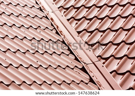 New red tiled metal roof at rain