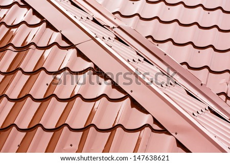 New red tiled roof at rain