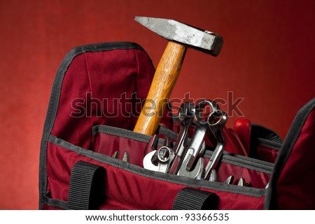new red toolbox on a wooden board