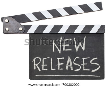 New releases - white chalk handwriting on a black clapboard