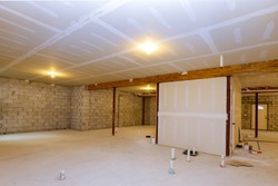 New residential construction home framing with basement unfinished view selected focus