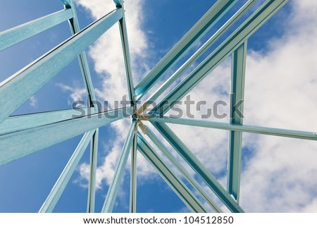 New residential construction home metal framing against a blue sky.Fragment.