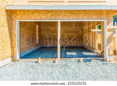 New residential home, garage under construction, framing. North America.