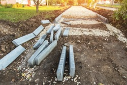 New road сonstruction. Repair sidewalk, walkway, pavement with cobblestone, curb, rubble and sand
