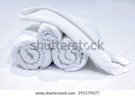 New rolled up white cloth beach towels.