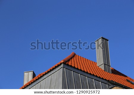 New roof with stainless steel cladded chimney
