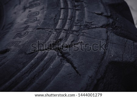 New rubber tire with tread for trucks and special construction wheeled vehicles for driving on asphalt roads and off-road, close-up. #1444001279