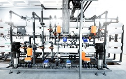 new shiny pipes and colorful equipment in industrial boiler room