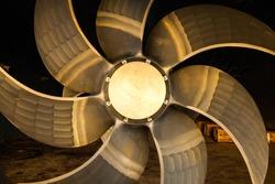 New ship's seven-blade bronze propeller, close-up.