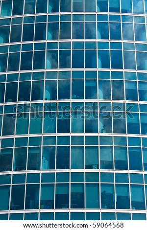 New skyscrapers business centre, climbers clean windows - stock photo