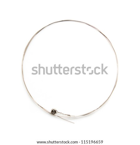 new string from a guitar on a white background. macro