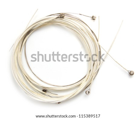 new string from a guitar on a white background. macro #115389517