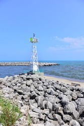New style port marker at the end of south pier at Racine Wisconsin.  The updated markers are more complex than the old pier lights.