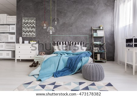 New style spacious bedroom with white furniture, floor panels and decorative wall plaster