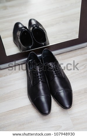 new stylish man shoe with mirror reflection