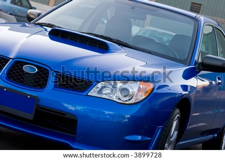 New Subaru sitting in a car lot waiting to be sold