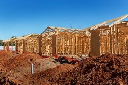 new suburban homes currently under construction in row