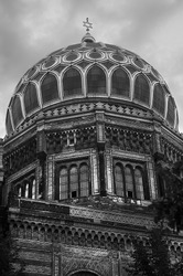 New Synagogue in black and white with a cloudy sky located in Berlin, Germany