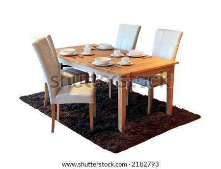 New table and chairs with place settings against isolated white background
