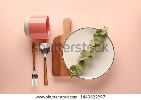 New tableware on color background #1440622997