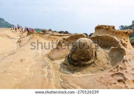 New Taipei City,Taiwan - March 15, 2015: Rock formation in Yehliu Geopark,Taiwan.People seen exploring around it.