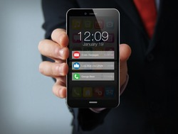 new technologies business  concept: businessman hand holding a 3d generated touch phone with notifications on the screen. Screen graphics are made up.