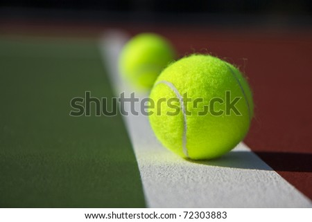 New Tennis Balls shot on  a outdoor tennis court