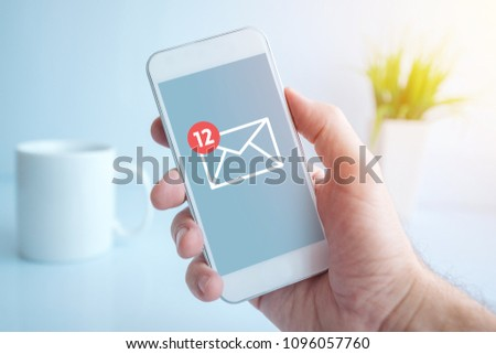 New text messages notification on smartphone screen in male hand, selective focus