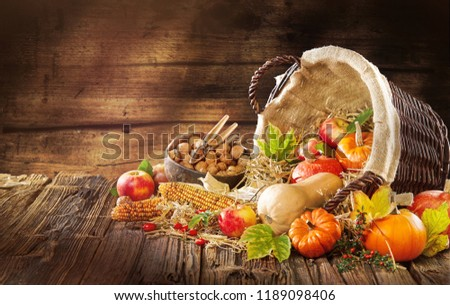 New Thanksgiving card creation for fall and autumn concepts. Rustic background with hokkaido Apples nuts and fall and autumn decorations on dark table with go to space and handwritten text . #1189098406
