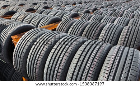 New tires for sale at a tire store. Car tires in the warehouse under the open sky