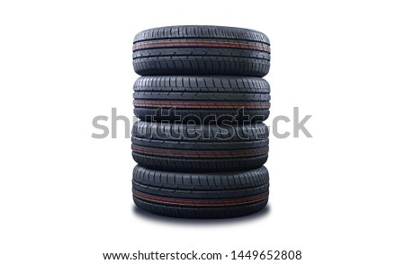 New tires pile isolated on white