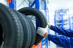 New tires that change tires in the auto repair service center in the stock blur for the industry, a four-wheeled tire set at a warehouse