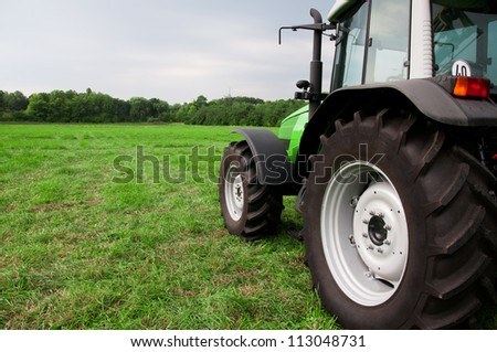 new tractor on a green field