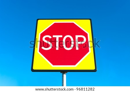 new traffic shield of a red stop sign in fluorescent yellow